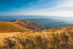 Fotógrafo no montanhas Imagens de Stock Royalty Free
