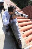Fotógrafo no telhado foto de stock