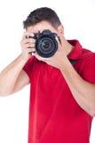 Fotógrafo novo com uma câmera Foto de Stock