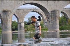 Fotógrafo profissional que trabalha duramente Fotografia de Stock
