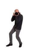 Fotógrafo que sostiene una cámara profesional Imágenes de archivo libres de regalías