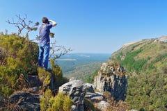 Fotógrafo que toma la foto de la hermosa vista del barranco del río de Blyde Fotografía de archivo libre de regalías