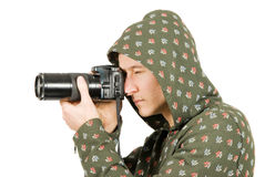 Fotógrafo que toma um tiro com uma câmara digital Imagens de Stock Royalty Free