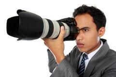 Fotógrafo que usa a câmera do dslr Imagens de Stock