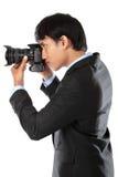 Fotógrafo que usa a câmera do dslr Foto de Stock Royalty Free