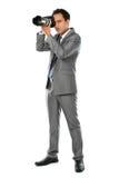 Fotógrafo que usa a câmera do dslr Fotos de Stock Royalty Free