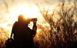 Fotógrafo Silhouette Fotografía de archivo libre de regalías