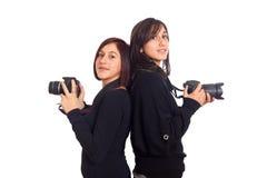 Fotógrafos de sexo femenino Foto de archivo