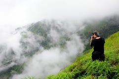 Fotógrafos y nubes Foto de archivo