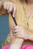 Fot för massageThailand massage med trä Fotografering för Bildbyråer