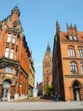 Fot- gata med traditionella norr europeiska byggnader för röd tegelsten i Hannover Royaltyfria Bilder