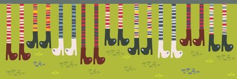 Fot i randiga sockor och kängor. Royaltyfri Fotografi
