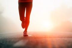 fot löparesoluppgång Arkivbilder