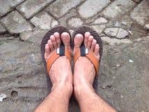 Fot med sandaler Arkivbild