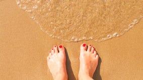 Fot på stranden royaltyfri foto