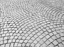 Fot- stenläggning i gata Arkivbilder