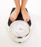 fot stora s-scales som väger kvinnan Royaltyfri Fotografi