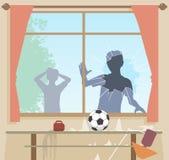 Fotboll bryter fönstret Fotografering för Bildbyråer