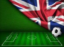 Fotboll- eller fotbollbakgrund med den Förenade kungariket flaggan stock illustrationer