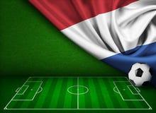 Fotboll- eller fotbollbakgrund med den Nederland flaggan royaltyfri illustrationer