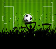 Fotboll- eller fotbollfolkmassabakgrund Arkivbild