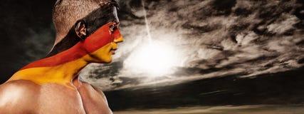 Fotboll eller fotbollsfan med bodyart på framsidan - flagga av Tyskland, Deutschland Royaltyfria Foton