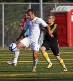 fotboll för spelare för bollKanada match royaltyfri foto