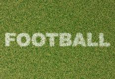 FOTBOLL - gräsbokstäver på fotbollfält Fotografering för Bildbyråer
