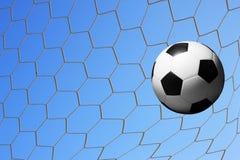 Fotboll i mål förtjänar. Royaltyfria Bilder