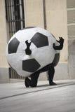 Fotboll klumpa ihop sig förklädnad Fotografering för Bildbyråer