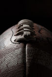 fotboll mot en mörk bakgrund Arkivbilder