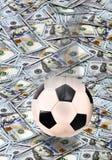 Fotboll och pengar Royaltyfri Bild
