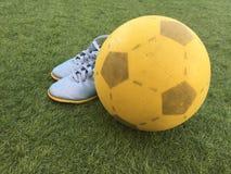 Fotboll och skor Royaltyfri Fotografi