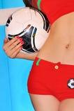 Fotboll och ung flicka Arkivbild