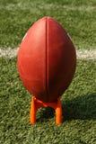 Fotboll på en sparka utslagsplats royaltyfri foto