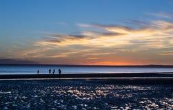 Fotboll på stranden på lågvatten Fotografering för Bildbyråer