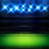 Fotbollbakgrund med strålkastaren Royaltyfria Bilder