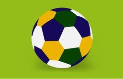 Fotbollboll av Brasilien i den gröna bakgrunden Arkivfoto