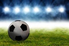 Fotbollboll i arena Arkivfoto
