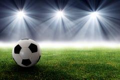 Fotbollboll i arena Arkivfoton