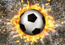 Fotbollboll i brand Royaltyfri Bild