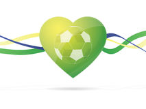 Fotbollboll i hjärta Brasilien flaggafärg Arkivbild