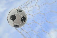 Fotbollboll i mål Royaltyfri Bild