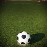 Fotbollboll i mål Royaltyfria Foton