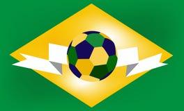 Fotbollboll i mitten av den Brasilien flaggan Fotografering för Bildbyråer