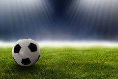 Fotbollboll i stadion på gräset Royaltyfria Bilder