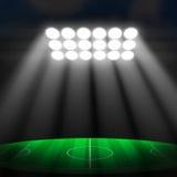 Fotbollboll på grön stadion Arkivfoton