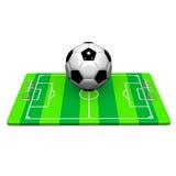 Fotbollboll på jordFront View Fotografering för Bildbyråer