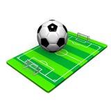 Fotbollboll på jordning Arkivbild
