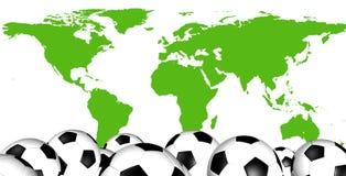 Fotbollbollar med världskartan Royaltyfria Bilder